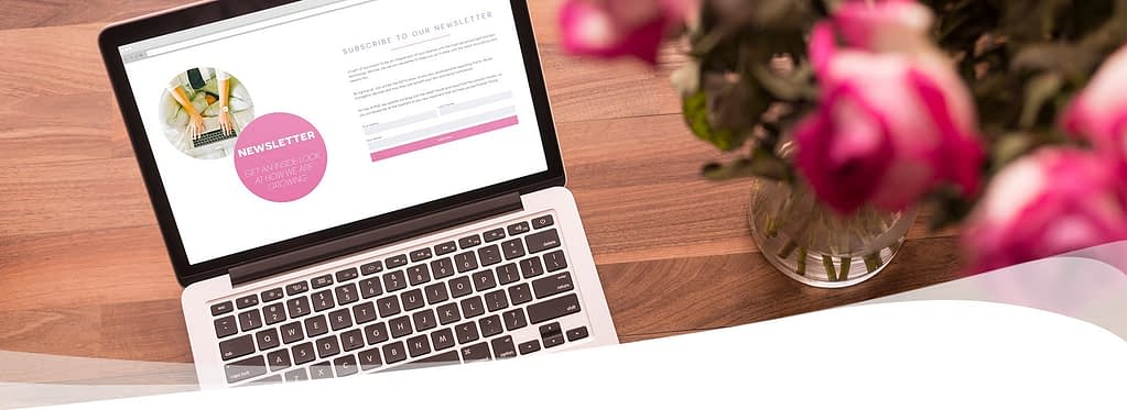 laptop on table with flowers showing dr muller website